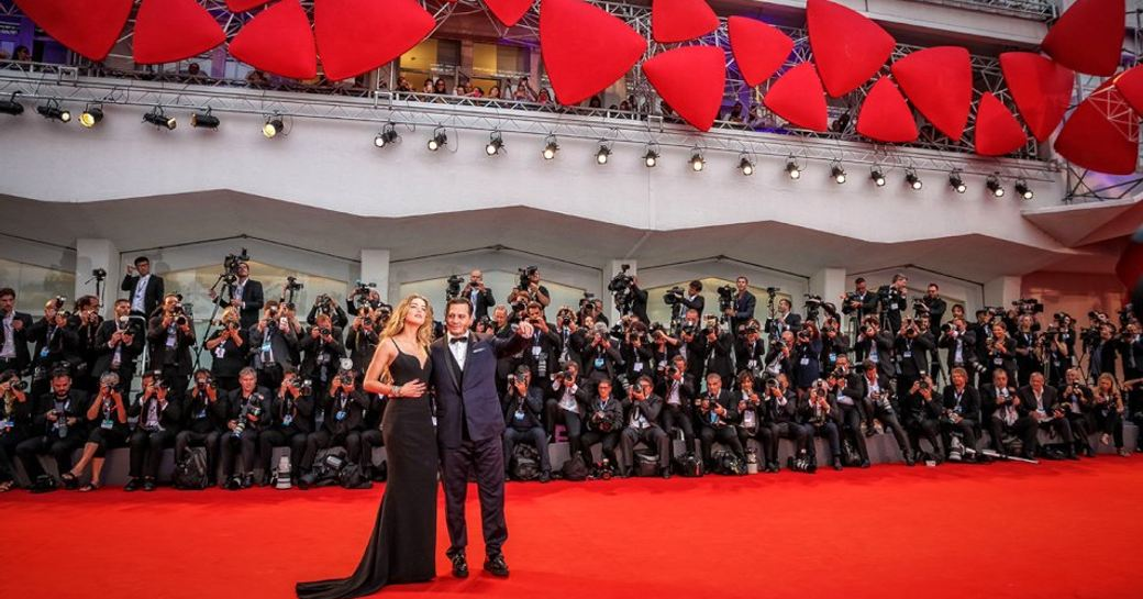 Actors on red carpet at the Venice Film Festival