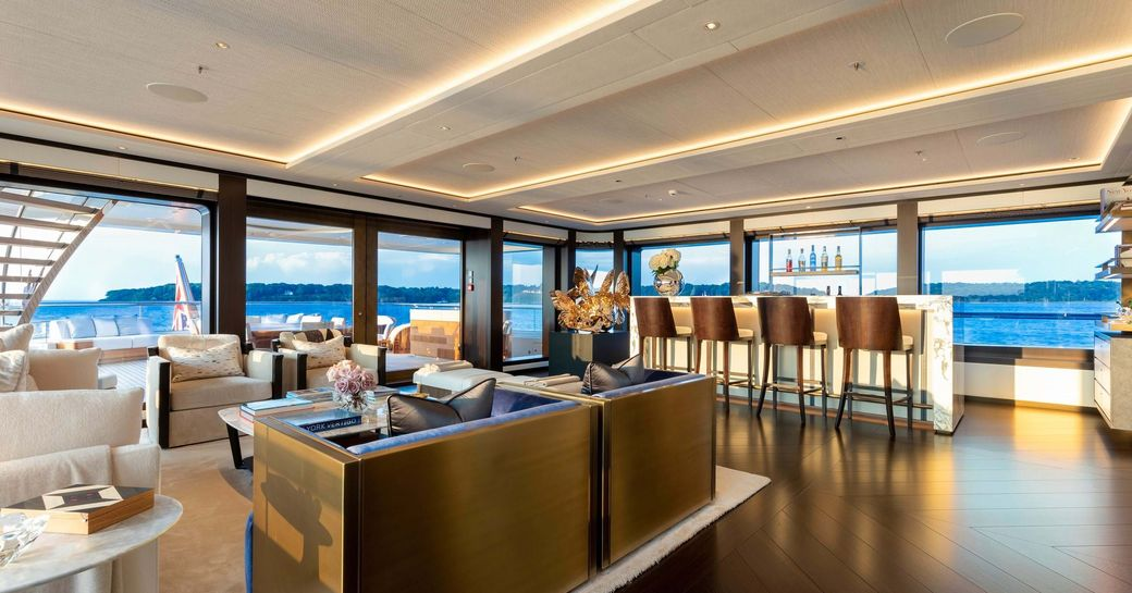 ibiza style interiors on superyacht hasna, with backlit onyx bar