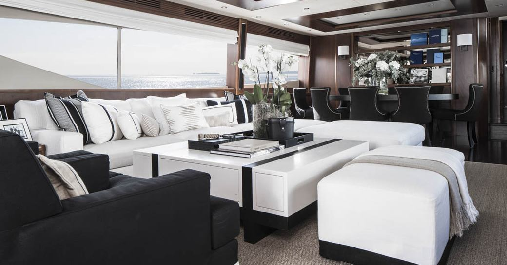 sumptuous sofa and armchair in the main salon seating area aboard luxury yacht CRISTOBAL
