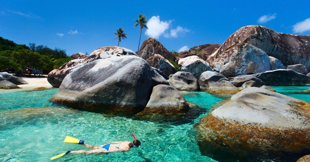 Woman snorkels in the Baths in Virgin Gorda, the British Virgin Islands
