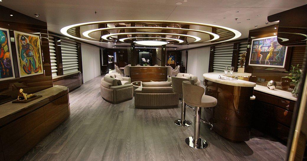 main salon on baba's yacht with marble bar and circular sofa seating