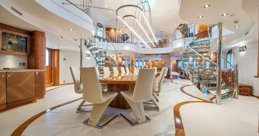 interiors of superyacht sherakhan; split level atrium with glass stairwell and marble flooring