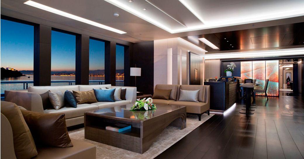 sensuous main salon with full-length windows on board luxury yacht Mogambo