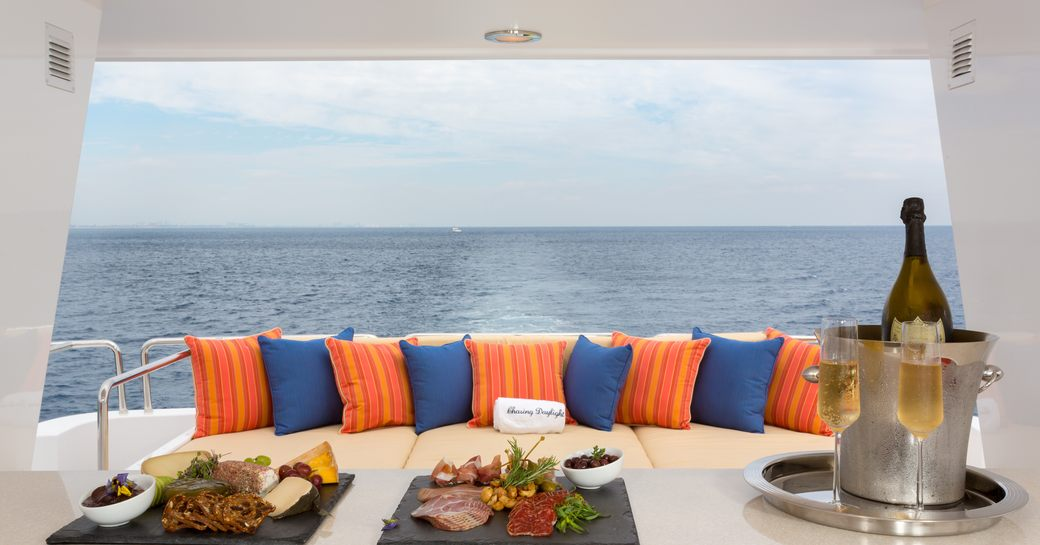 dinner and champagne served aboard motor yacht 'Chasing Daylight'