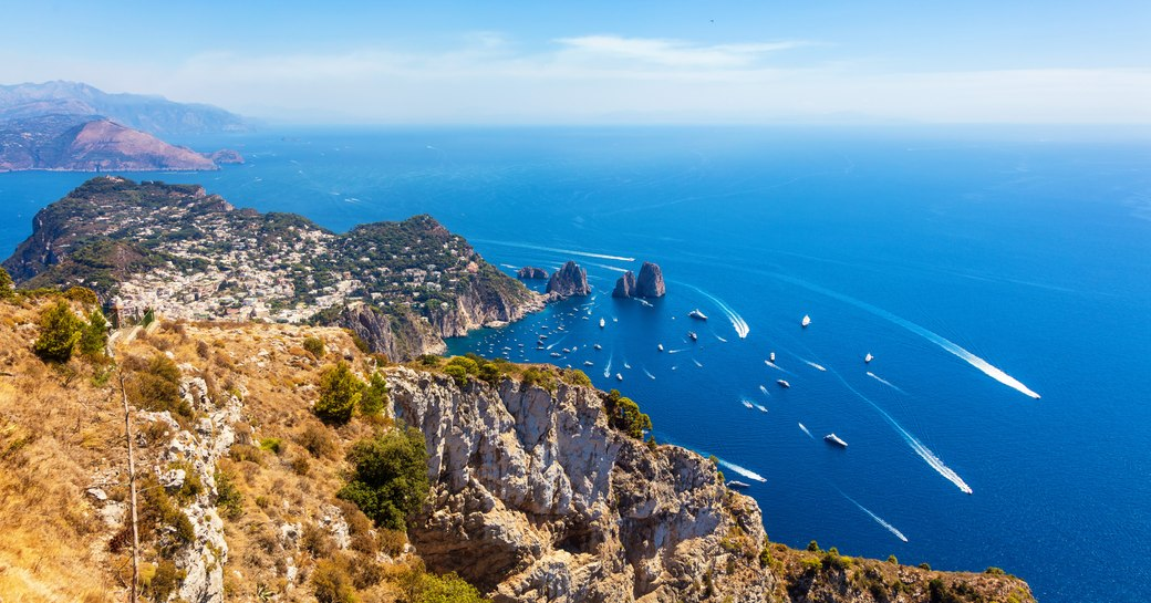 aerial shot of yachts in the island of capri