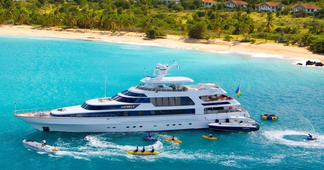 Luxury yacht AZZURRA II underway, with toys and tenders alongside