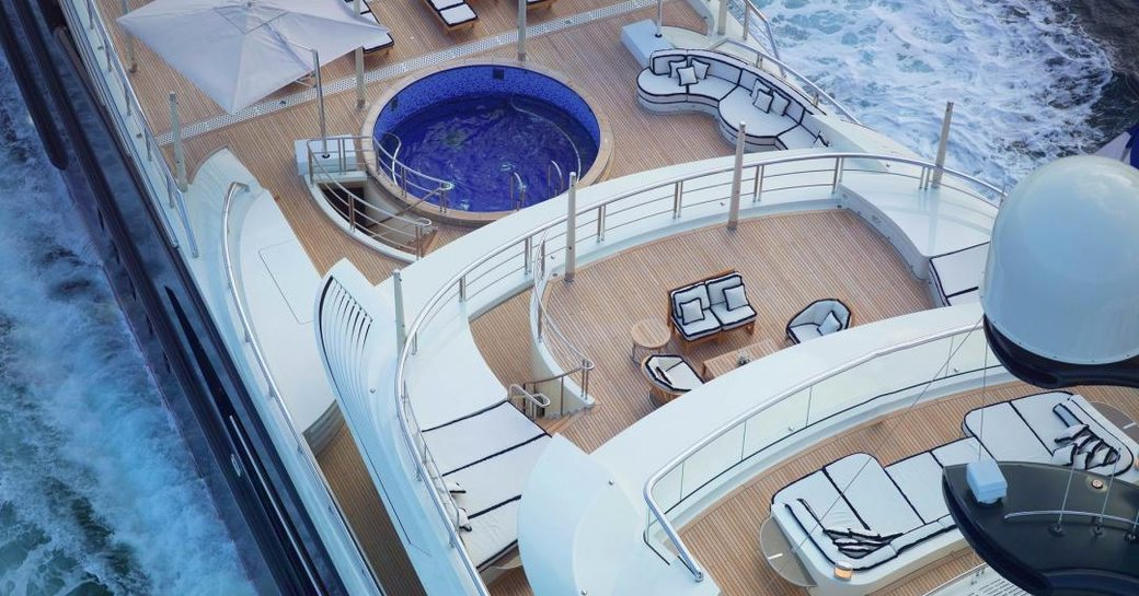 Aerial view of superyacht EQUANIMITY aft deck pool and seating areas