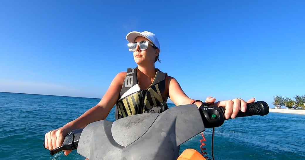 woman rides waverunners in the sea near thanda island
