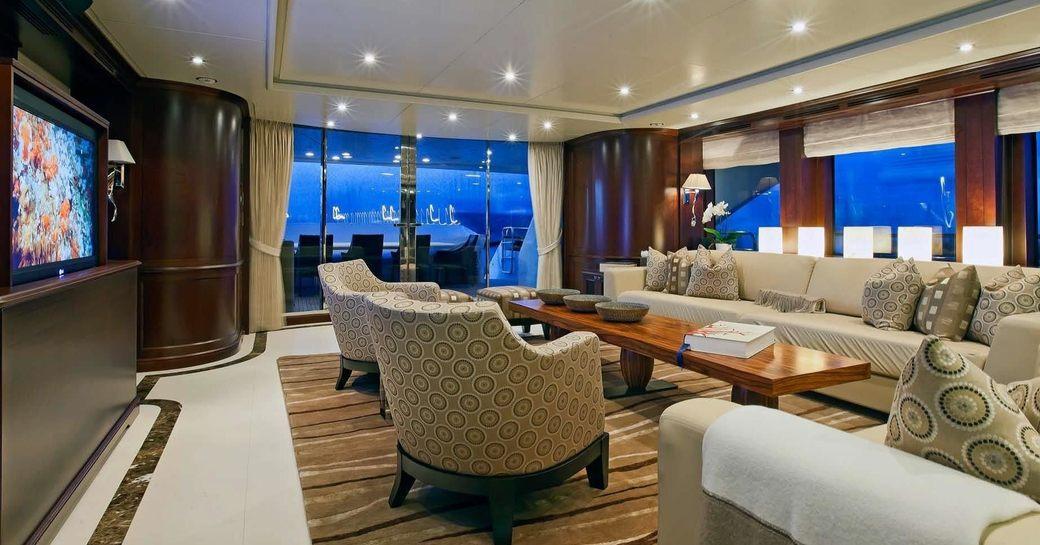 cherrywood main salon aboard motor yacht 'Pure Bliss'