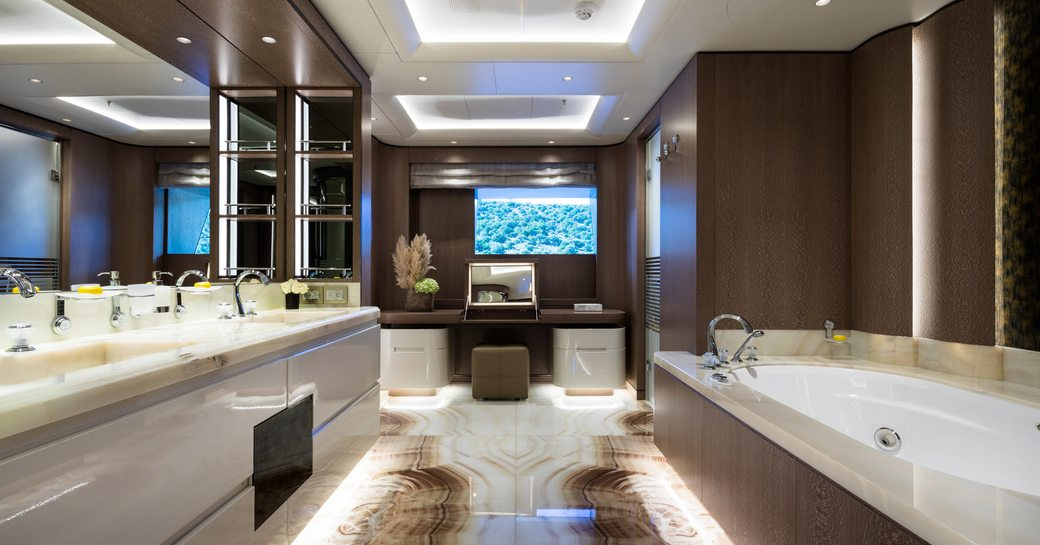 Luxury ensuite with marble effect sink and bathtub on superyacht O'PARI