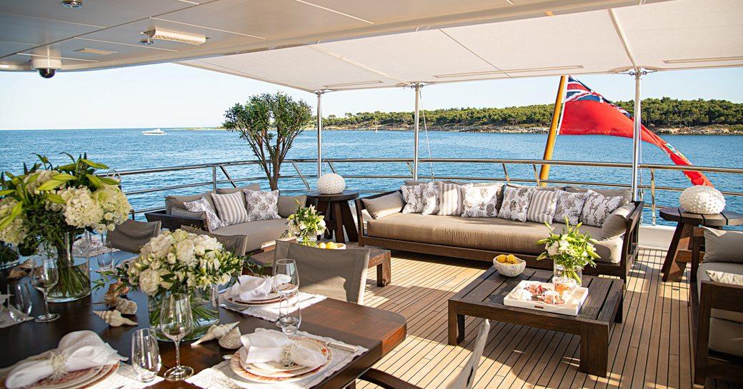 alfresco dining area and sofa seating on superyacht spirit