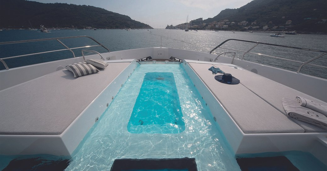 Luxury yacht MA on the foredeck, with sunpads either side