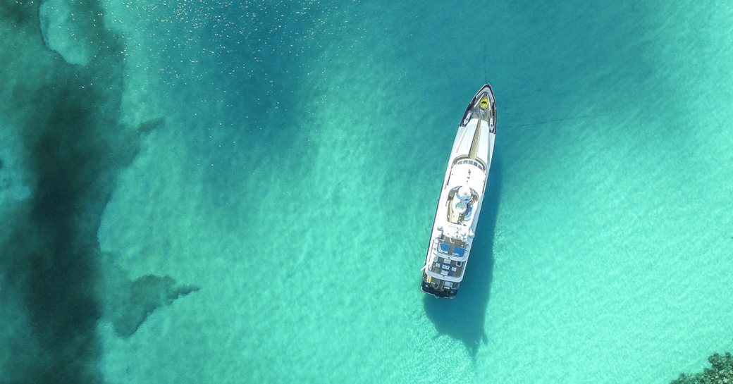 Yacht cruising in turquoise waters