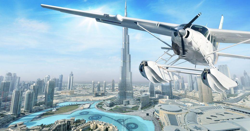 a seawings plane soars over Abu Dhabi