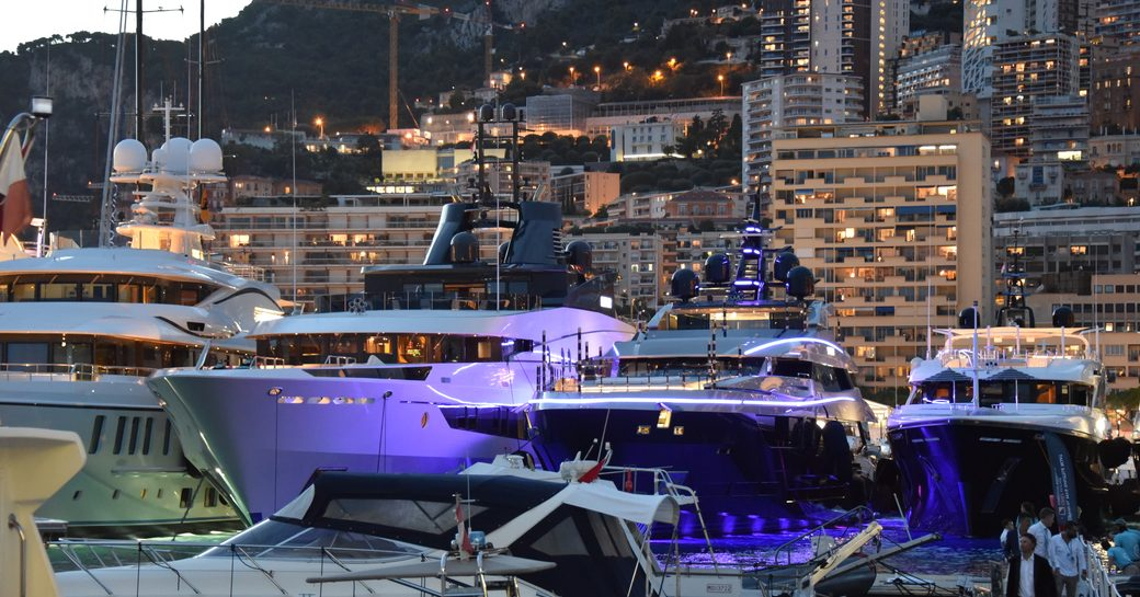 port hercules harbour by night, superyacht in line
