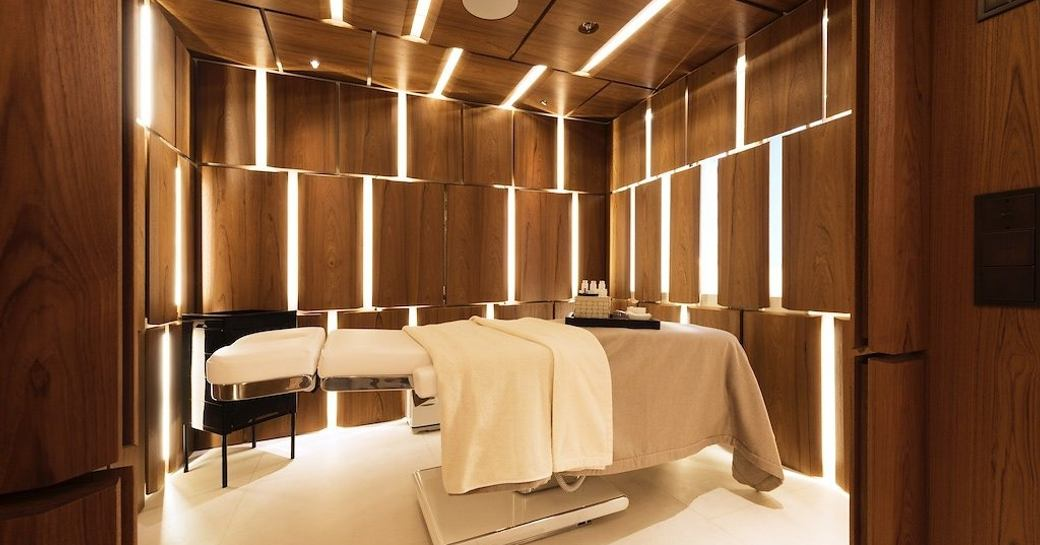 A massage bed illuminated by recessed lighting on board superyacht CLOUDBREAK