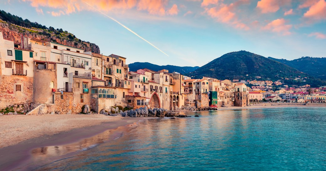 Attractive evening cityscape of Cefalu town. Amazing sunset on Mediterranean sea, Sicily, Italy, Europe.