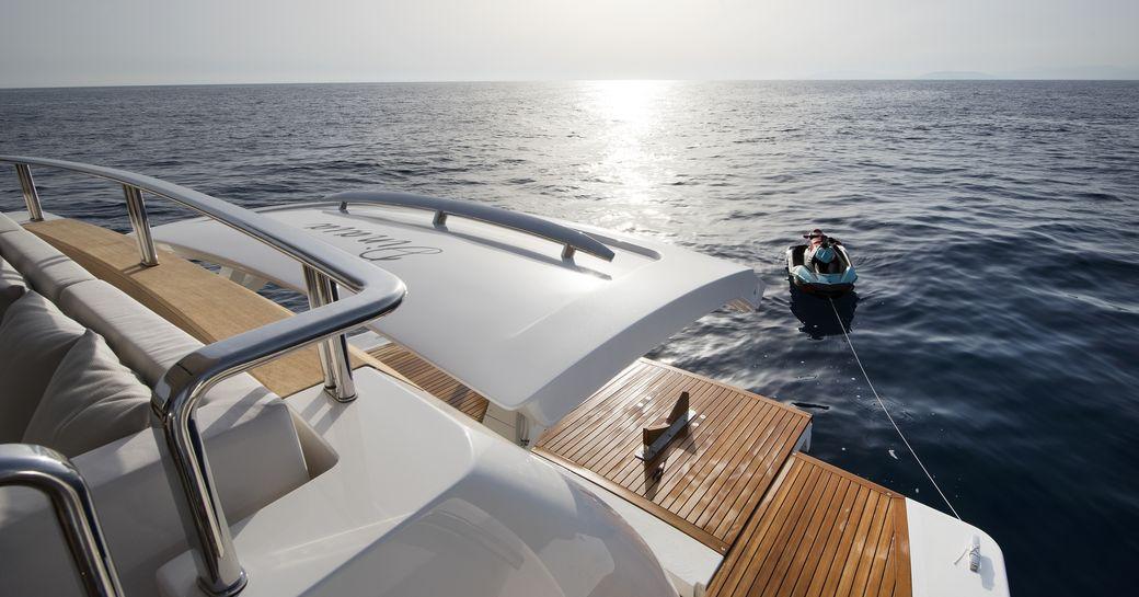 transom door opens on the swim platform of charter yacht DINAIA
