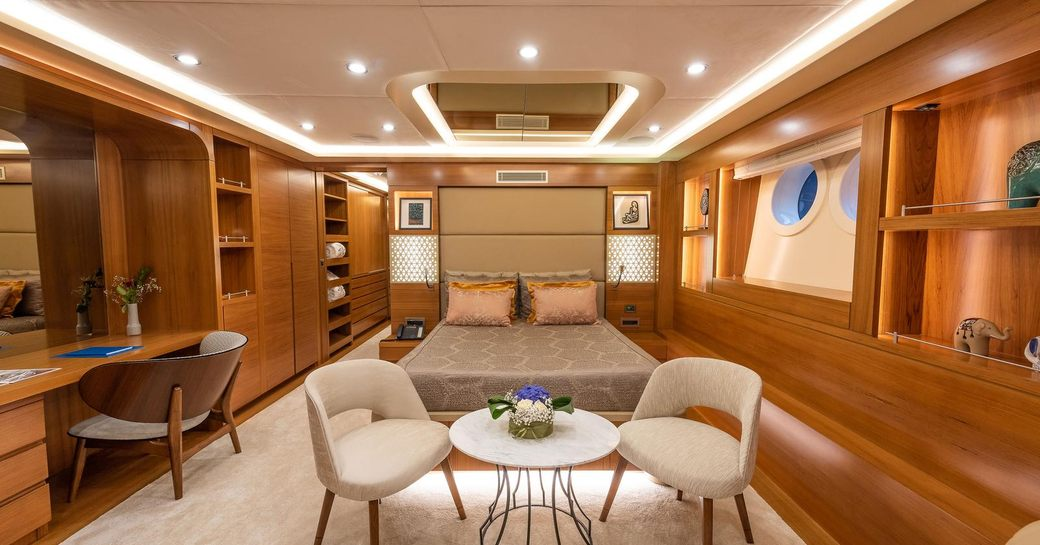 View of luxury cabin on sailing yacht ARESTEAS, with table at foot of bed and study area