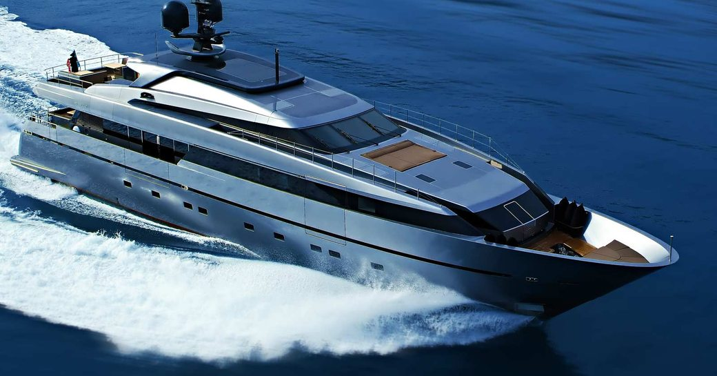 Luxury yacht 4A slicing through the water aerial shot