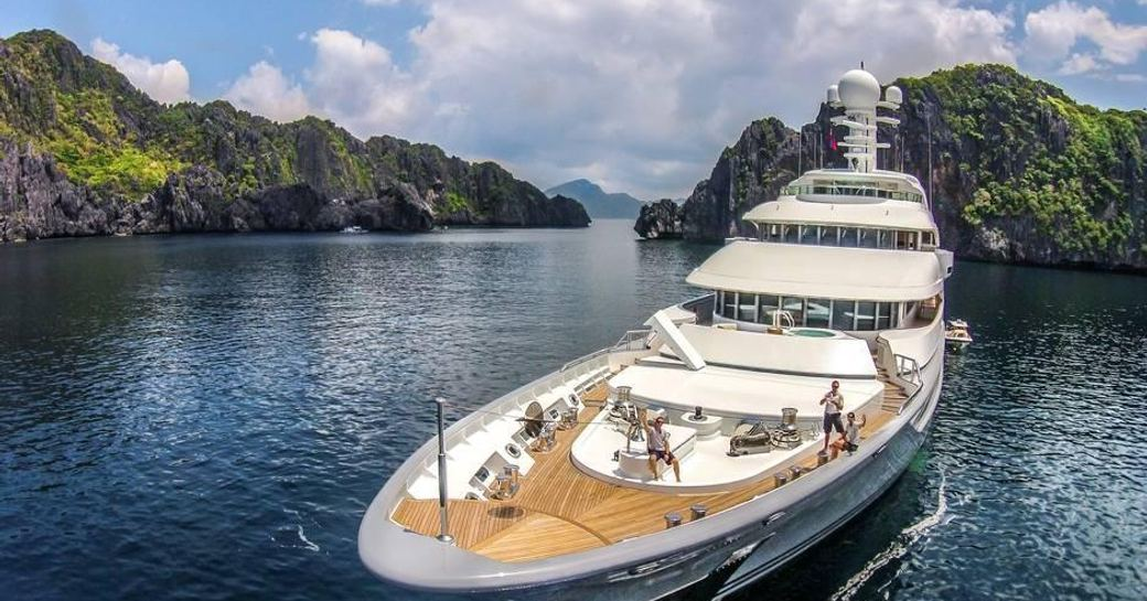 Charter guests enjoy the outdoor deck of luxury yacht TV