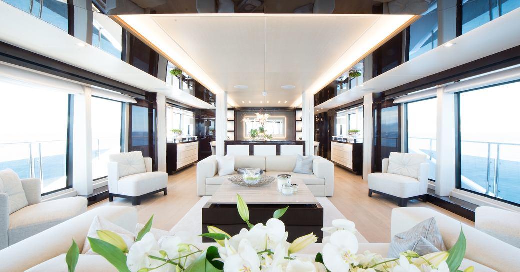 stylish formal lounge in main salon aboard superyacht JACOZAMI