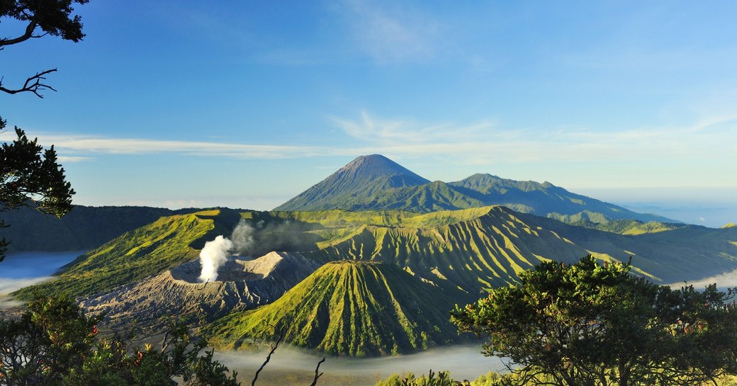 beautiful vista of Mount Bromo against clear blue sky in Java, Indonesia