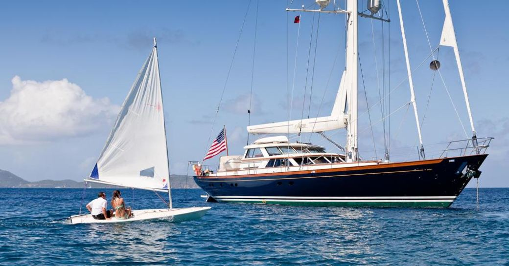 Charterers approach sailing yacht MARAE on an extended tender