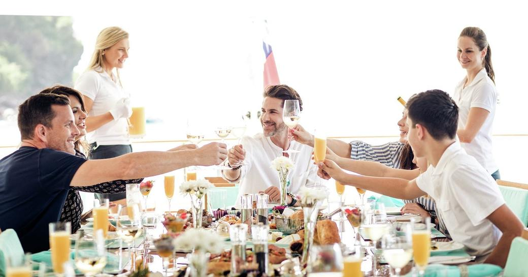 A group of friends enjoying mimosas while on their luxury yacht charter vacation through the Mediterranean