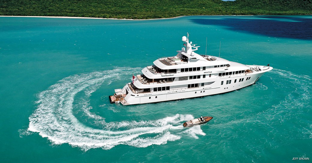 invictus yacht at anchor with tenders around her