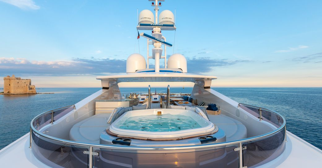 spa pool surrounded by seating on the sundeck of a superyacht