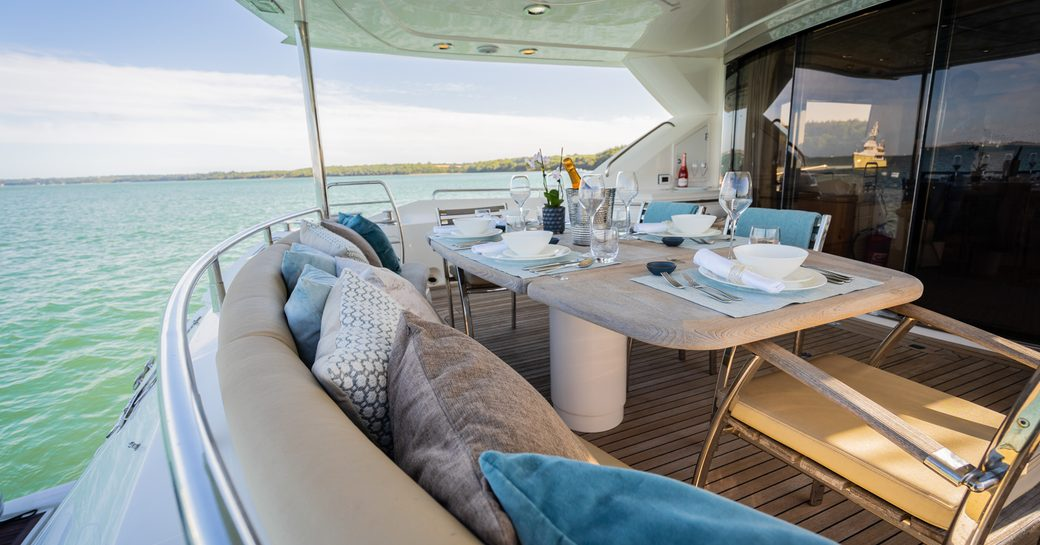 dining arrangement on the aft deck of luxury motor yacht chess