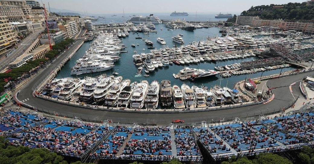 Port Hercules marina in Monaco, with charter yachts lined up opposite the track waiting for the Monaco Grand Prix to begin