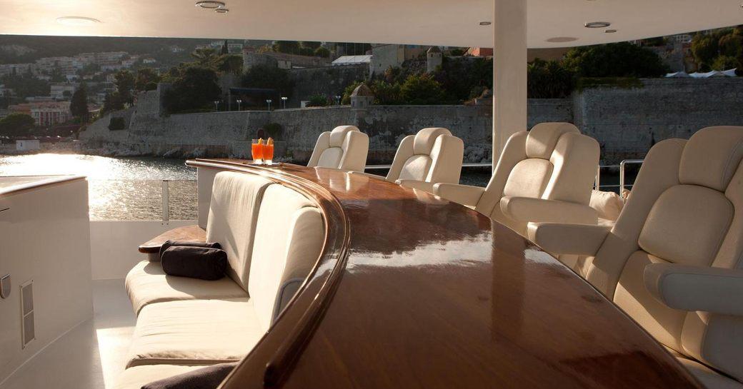 Sundeck wet bar and seating on luxury yacht AZZURRA II