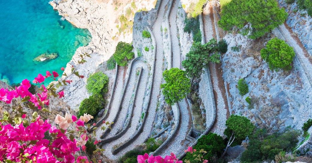 Lovely path in Capri overlooking the Mediterranean sea