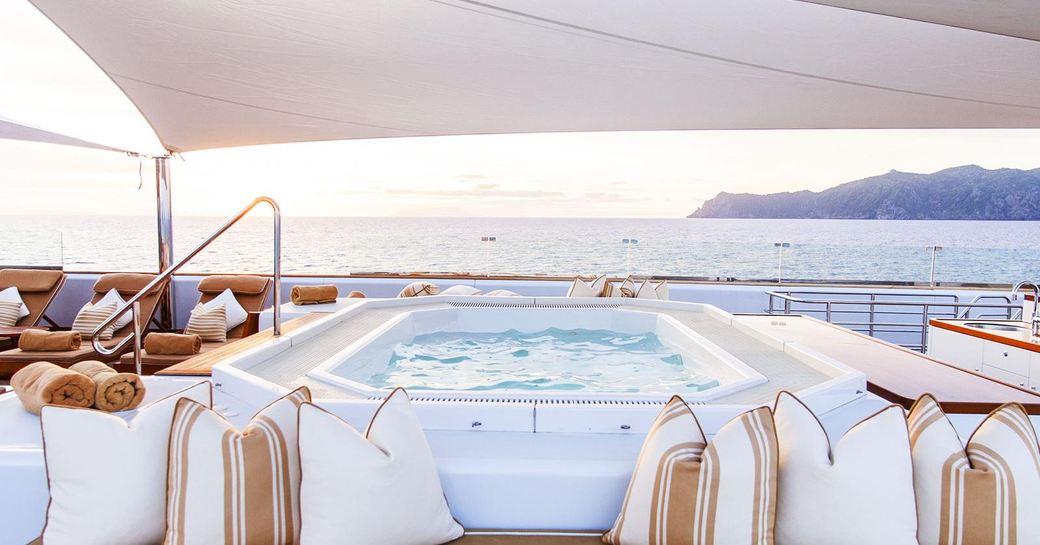 Sun deck jacuzzi with sofa seating on superyacht Suri