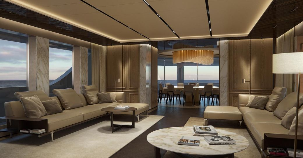 THE SPACIOUS AND AIRY MAIN SALON OF SUPERYACHT GECO OVERLOOKING THE WATER