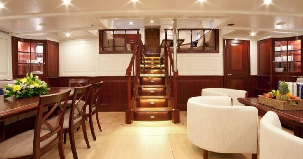 Sailing yacht Aurelius 111 main salon with steps and dining
