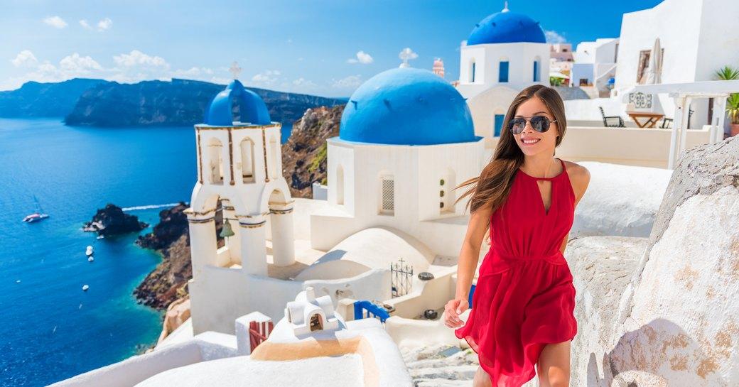 woman climbs steps on the greek island of santorini