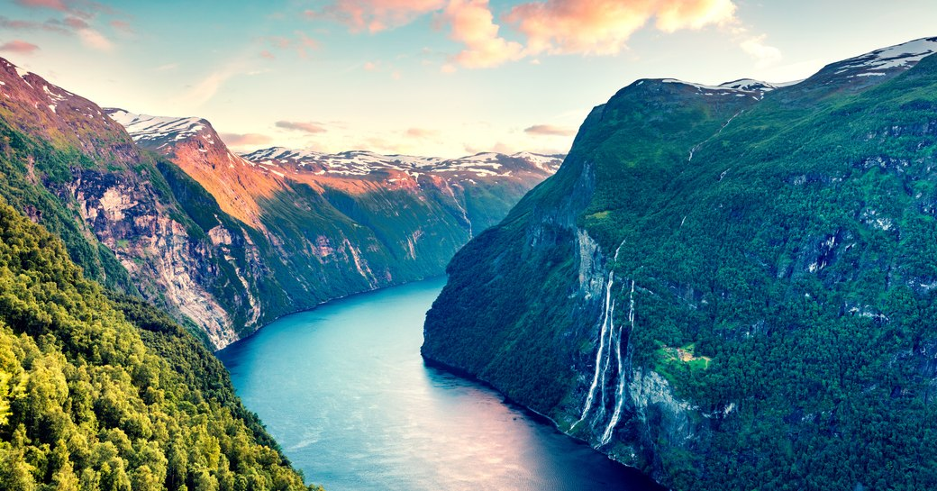 aerial shot of fjord in norway, with waterfall
