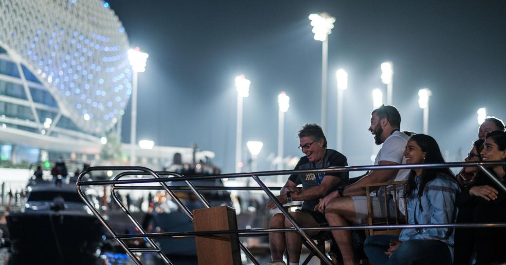 People watch the F1 from a yacht during the Abu Dhabi Grand Prix