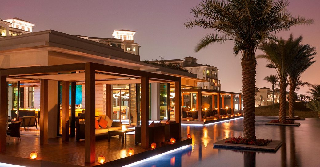 Sontaya restaurant surrounded by water features and palm trees in St Regis Saadiyat Island Resort, Abu Dhabi