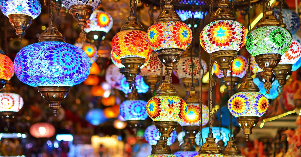 Painted lights hanging from ceiling in bazaar in turkey
