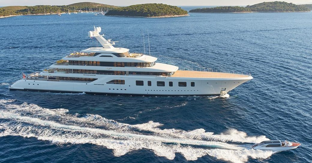 the luxurious superyacht Aquarius underway in the Caribbean on her luxury yacht charter