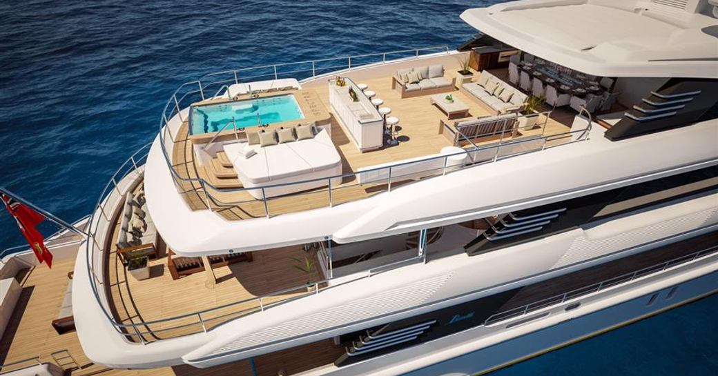 Superyacht SPECTRE sun deck aerial shot with view of glass-rimmed pool and bar area