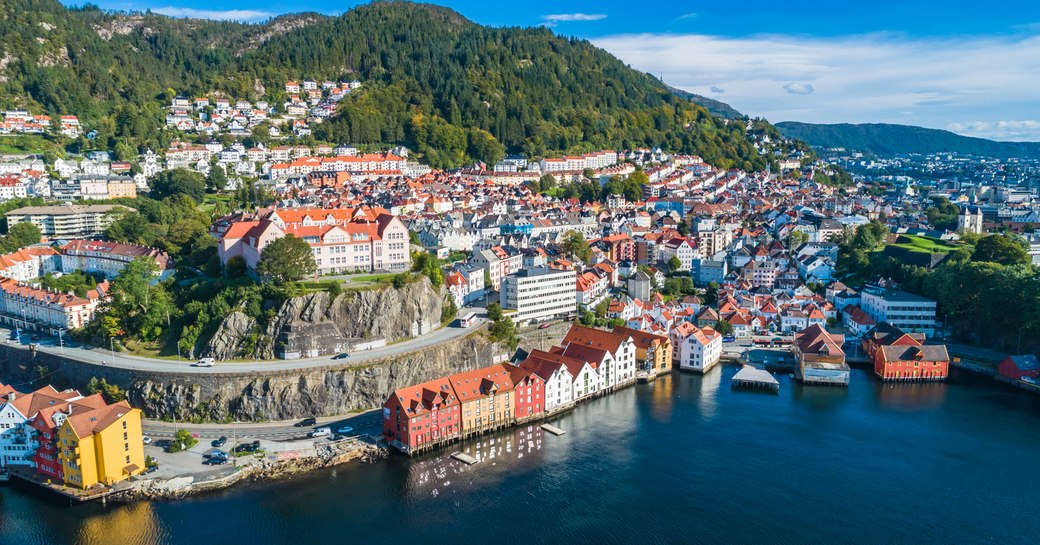 pastel colored houses on the waterfront in norway