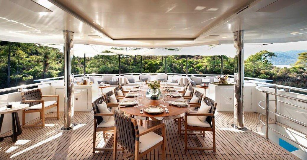alfresco dining on aft deck of superyacht Orient Star