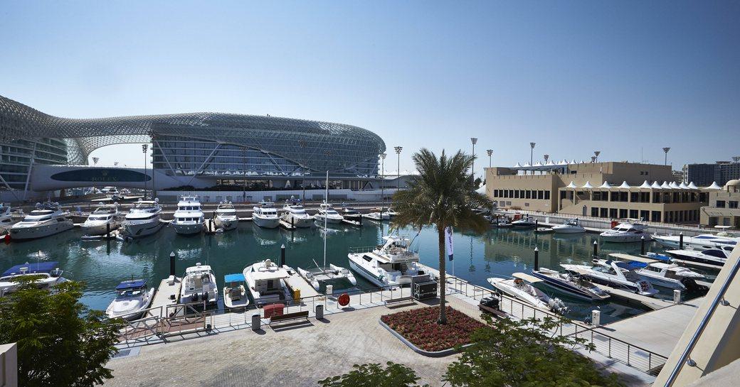 Trackside berths at Abu Dhabi Grand Prix, multiple motor yachts moored in Yas Marina.