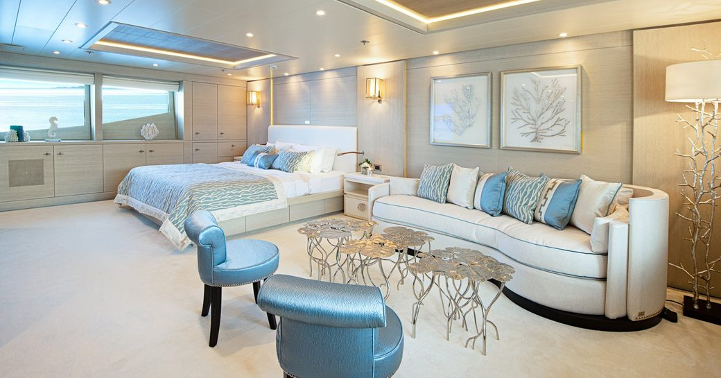 luxury yacht spirit master cabin, with large bed and lounge area