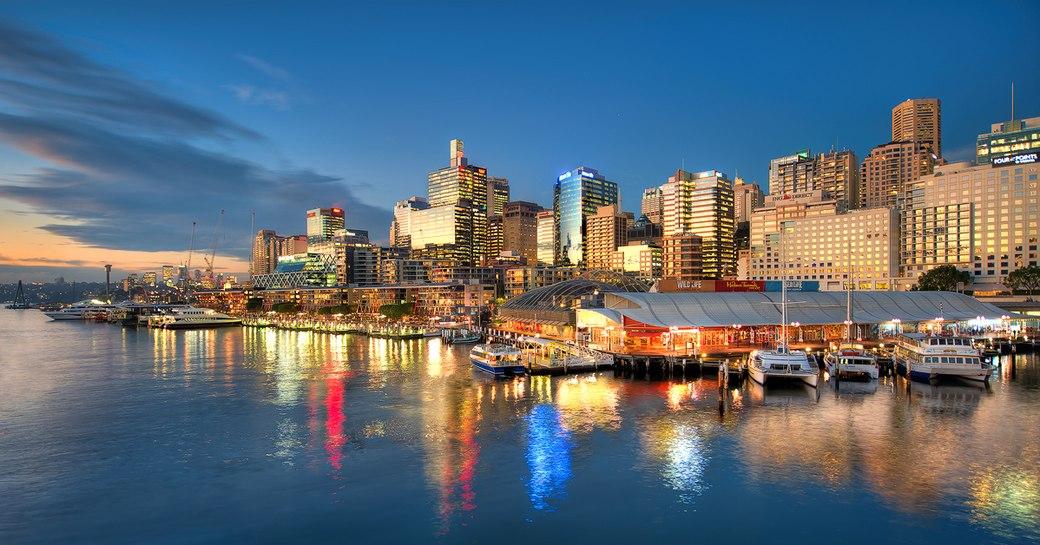 upmarket bars and restaurants line King Street Wharf as the sun sets over Sydney Harbour